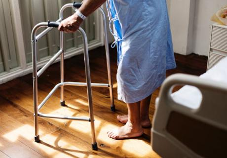 Elderly person with a walker